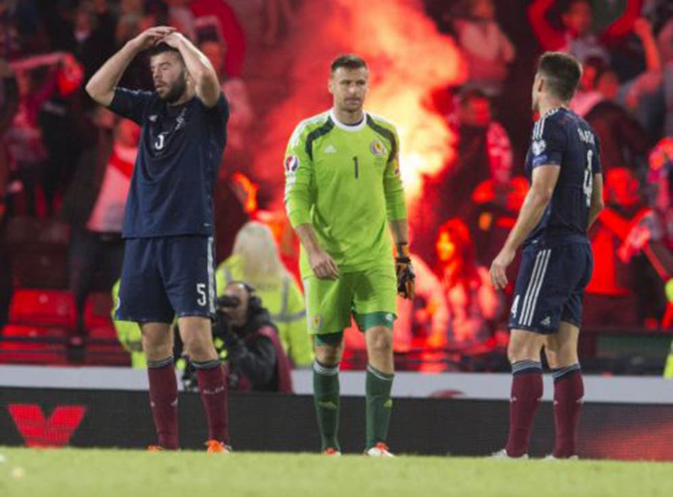 Grant Hanley, David Marshall and Russell Martin show their dejection at the final whistle
