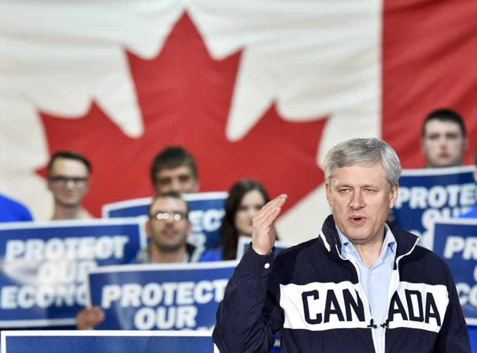Conservative leader Stephen Harper speaks at a rally during a campaign stop in Bay Robert's