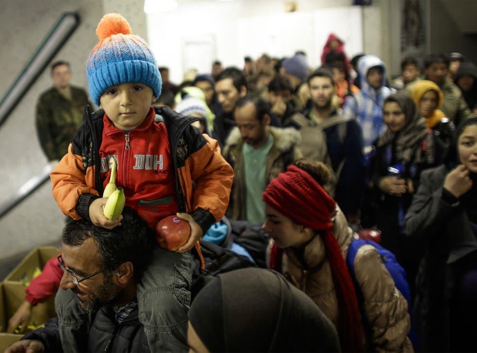 Refugees arrive by train at Schoenefeld near Berlin