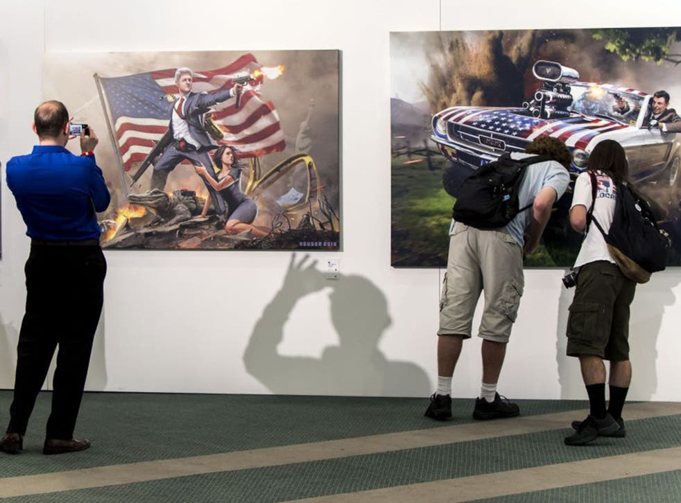 Politicon fans at an art show on the first day of the event