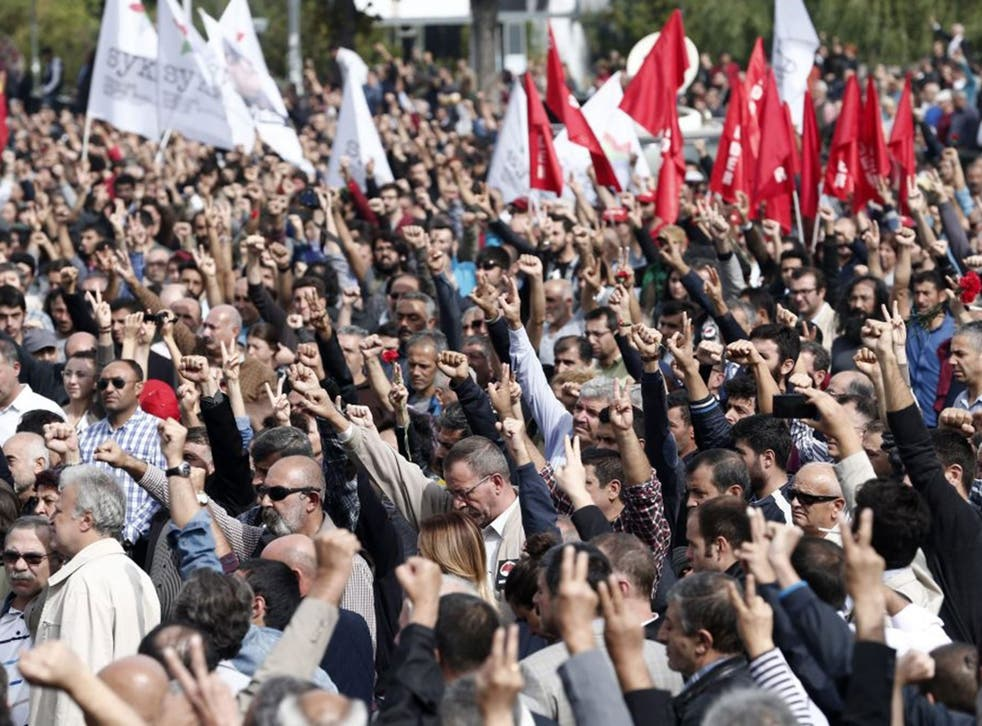 People raise their fists as a salute for victims during a demonstration on the day after a twin blast in Ankara that killed at least 128 people, in Ankara, Turkey, 11 October 2015.