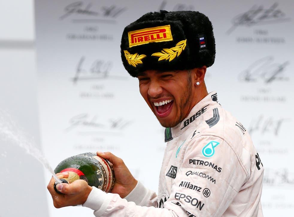 Lewis Hamilton celebrates victory in the Russian Grand Prix
