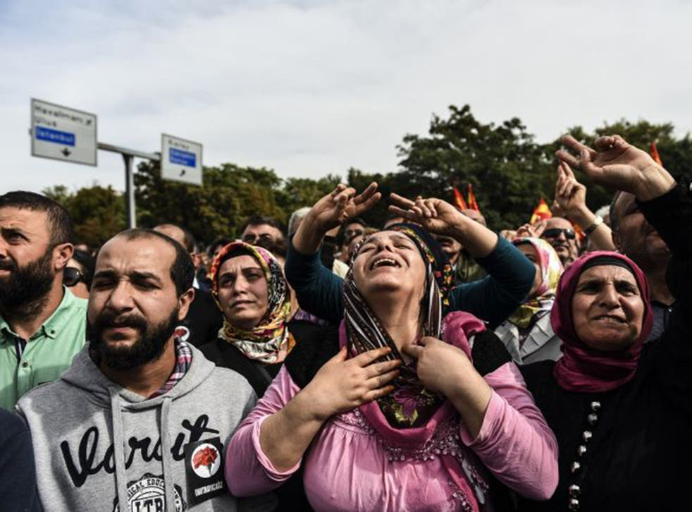 Protesters at the scene of the bombing in Ankara yesterday; they chanted 'Murderer Erdogan' and there were skirmishes with police