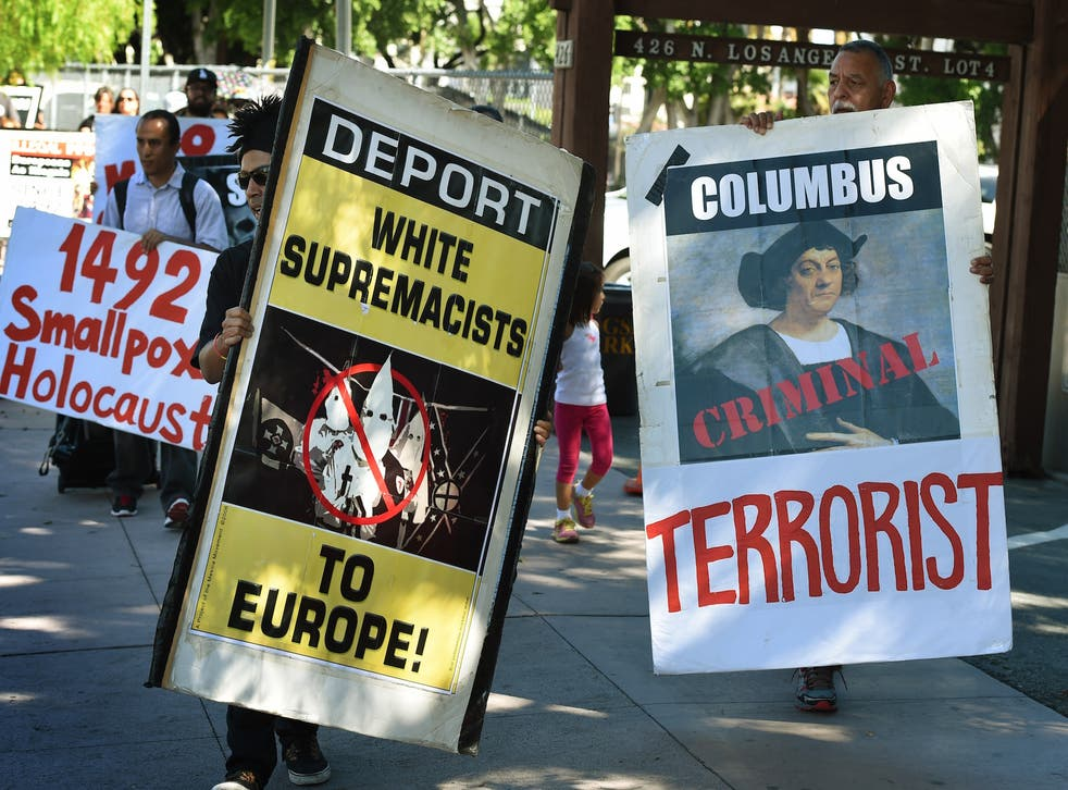 Demonstrators protest Columbus Day in Los Angeles.
