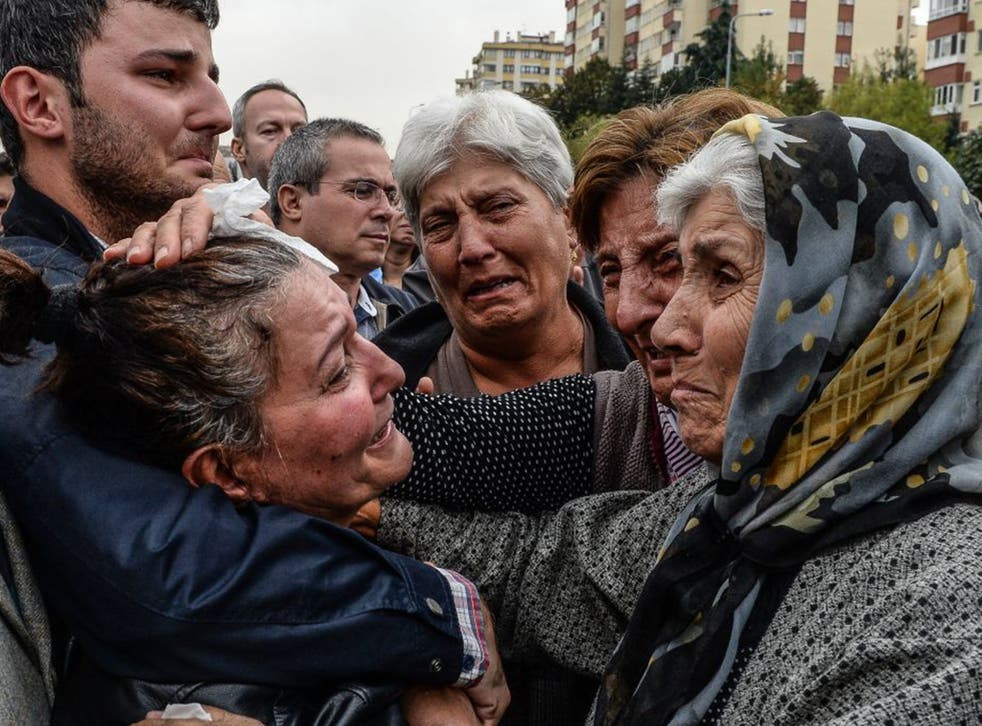 Friends and relatives of one of the victims of Saturday's bombing attacks mourn at his funeral in Ankara. No group has yet claimed responsibility for the twin bombing that killed at least 97 people in the Turkish capital