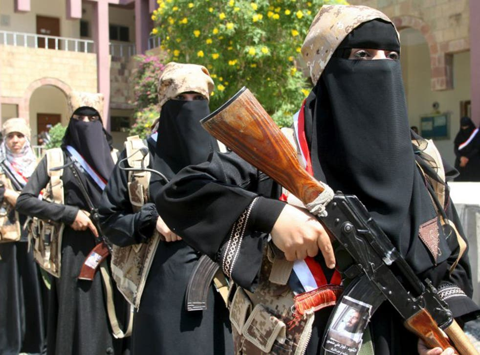 Female fighters in the Popular Resistance, an anti-Houthi militia, attend a 'graduation ceremony' in Taiz