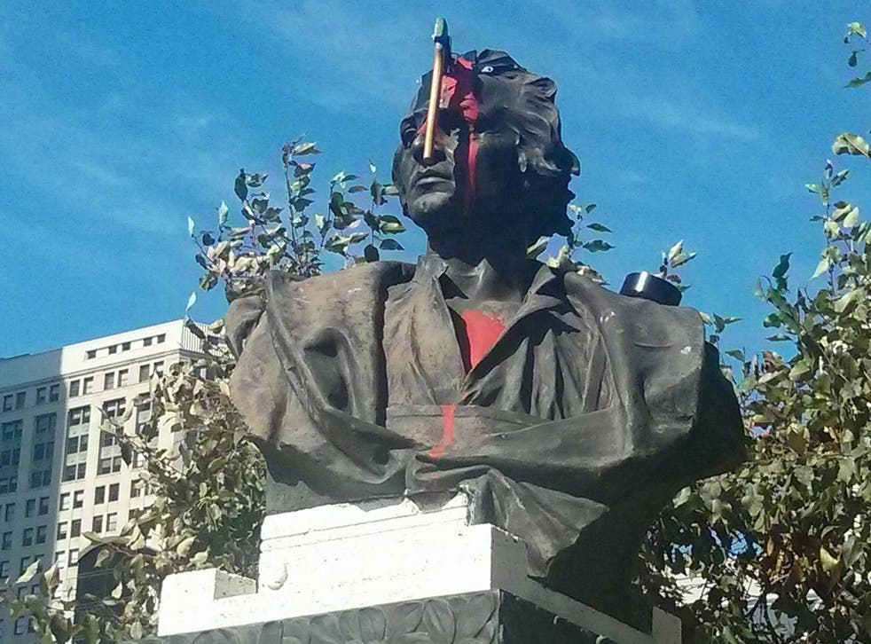 This Christopher Columbus statue has a new feature, a bloody hatchet to the forehead.