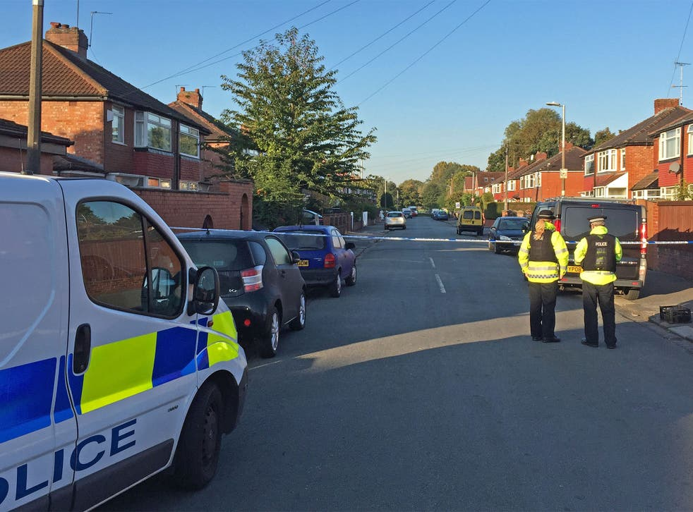 The pair suffered leg wounds and were taken to hospital after the attack in Gillingham Road, Salford