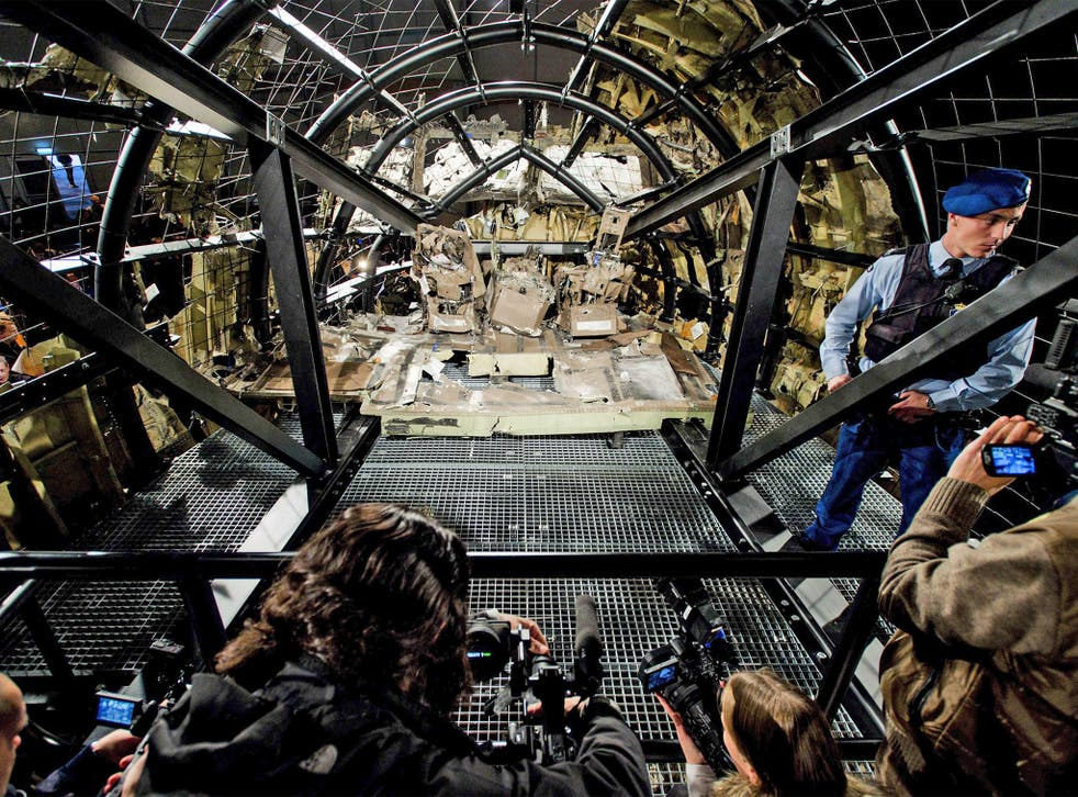 A view of the rebuilt cockpit section of Malaysia Airlines flight MH17 during a press conference to present the report findings of the Dutch Safety Board in Gilze Rijen