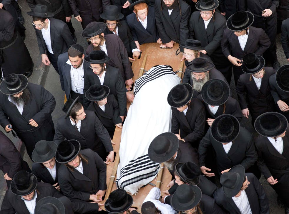 Utra-Othodox Jews attend the funeral of Yishaya Krashevsky. He was killed when a Palestinian drove a car into pedestrians