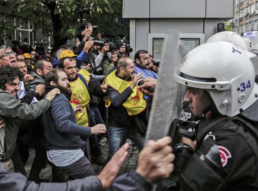 Protesters clash with Turkish riot police during a demonstration in Istanbul against the deadly attacks in Ankara