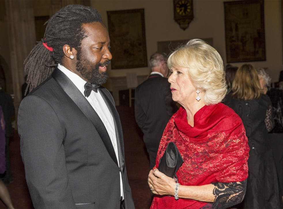 Marlon James speaks with the Duchess of Cornwall at the award ceremony