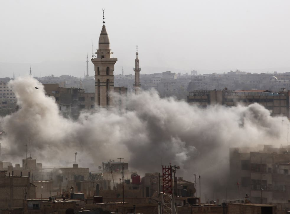 An air strike hits the historic Syrian city of Douma