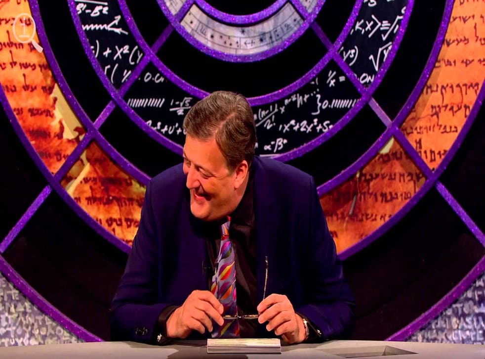 Stephen Fry presenting the comedy show QI