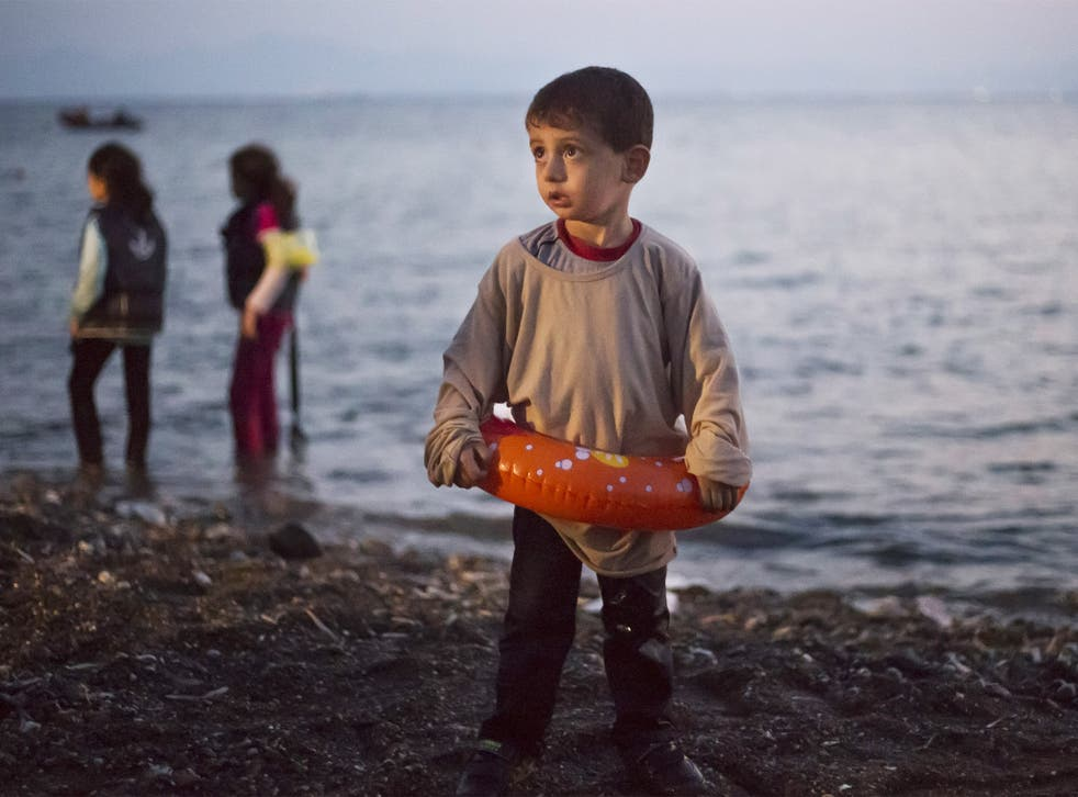 A young Syrian boy arrives on the island of Kos, which is struggling to cope with the record numbers of refugees