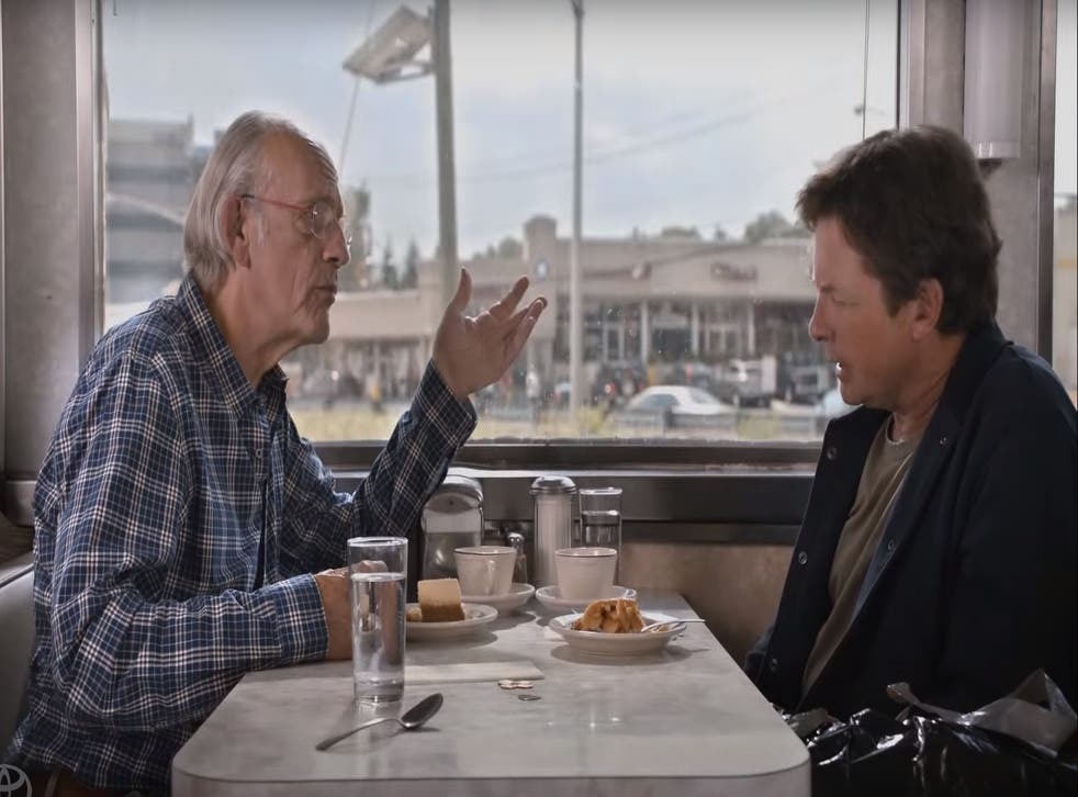 Michael J. Fox and Christopher Lloyd discussing Back to the Future II