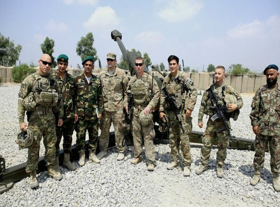 US and Afghan forces pose in Afghanistan