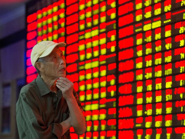 An investor observes the stock market at a stock exchange hall in Nanjing, China, last year