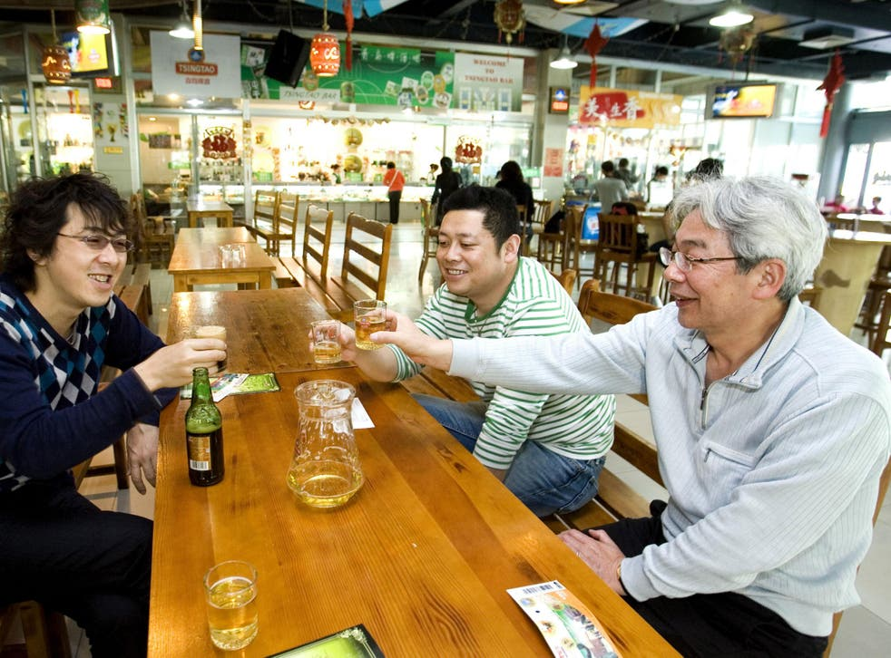 Customers drink beer in the Tsingtao beer museum  brewery on May 17, 2009 in Tsingtao beer street, in the town of Qingdao, Shandong province, China.