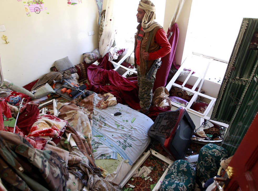 A Yemeni man inspects the damage in his house following air strikes carried out by the Saudi-led coalition in the capital Sanaa.