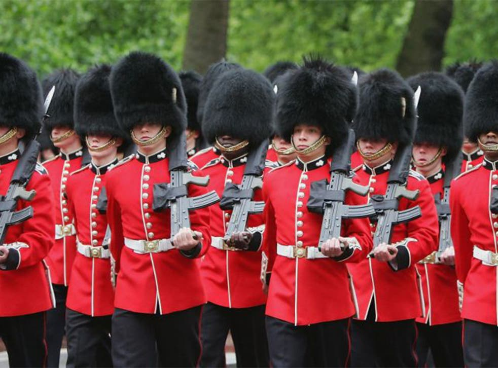 The Queen's Foot Guards march during training for the Trooping of the Colours ceremon