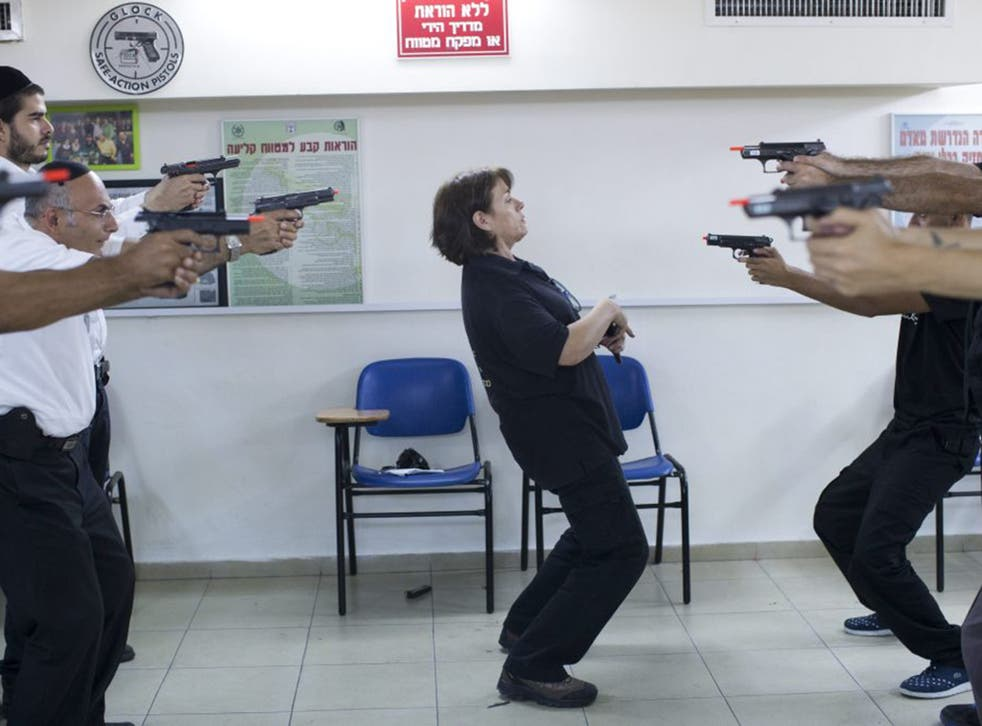 Israelis practice their shooting skill at a shooting range in Jerusalem. Local media have reported on an increase in weapon permit applications from Israeli citizens due to the tense security situation in the country