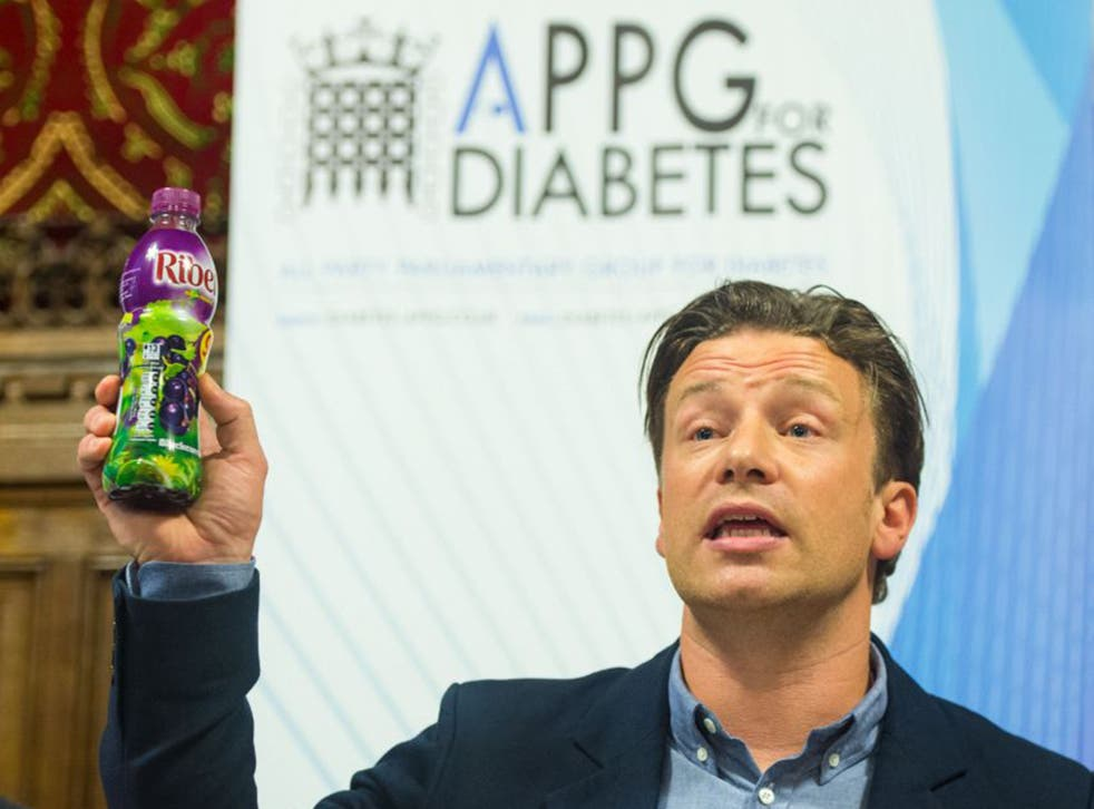 Jamie Oliver holds up a bottle of Ribena as he speaks at a meeting of the All Party Parliamentary Group for Diabetes at the House of Commons