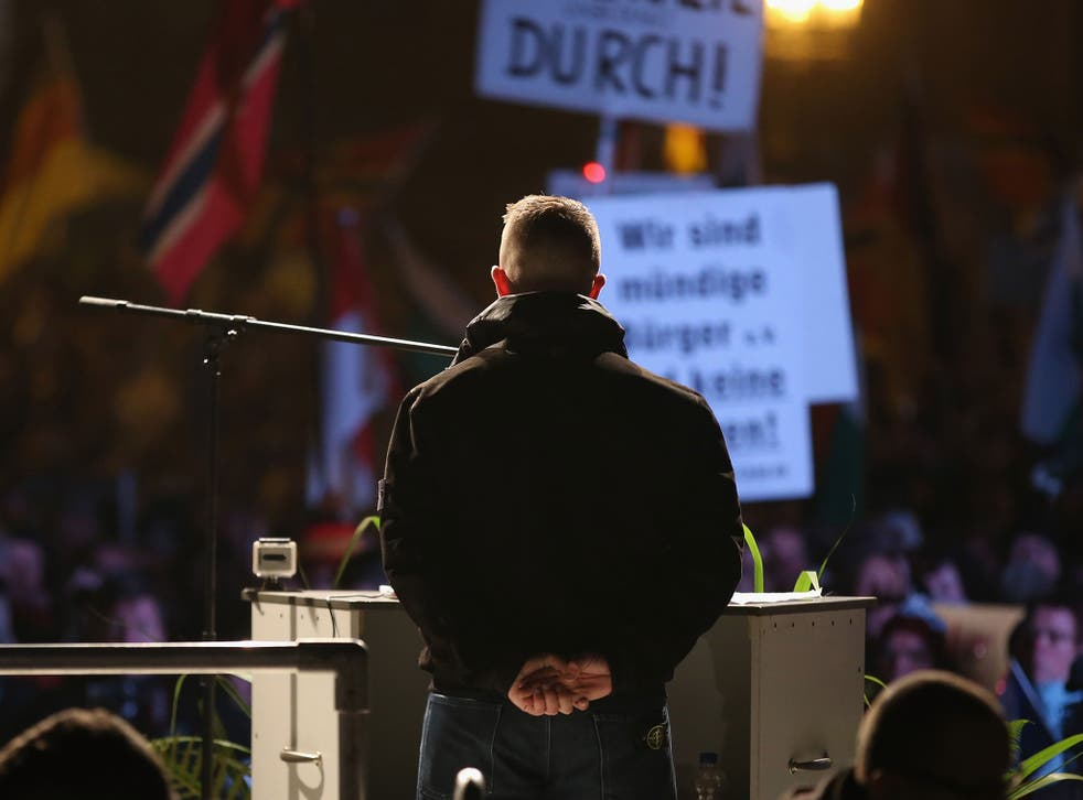 Tommy Robinson addressing Pegida supporters in Dresden on 19 October