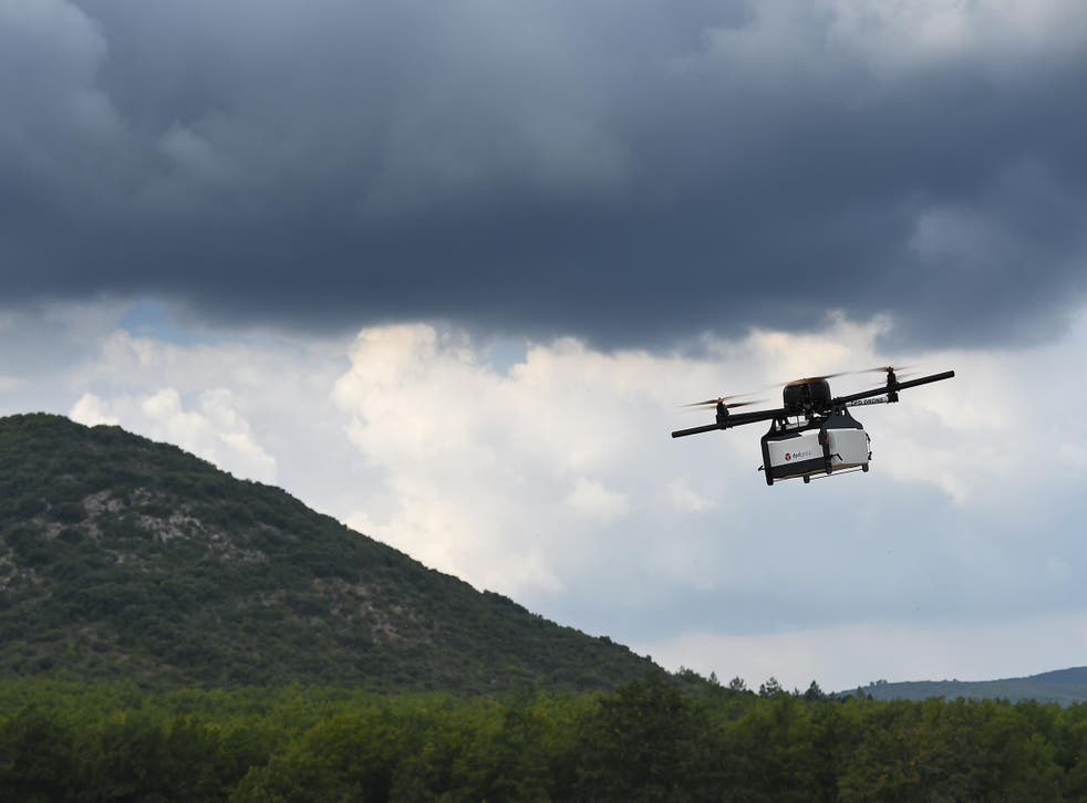 A prototype delivery drone developed by French company Geopost takes part in a test flight