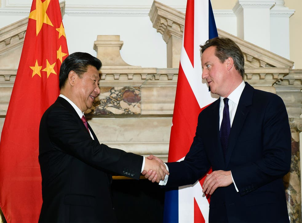 The  Prime Minister shakes hands with the President Xi Jinping during a commercial contract exchange at the UK-China Business Summit in Mansion House