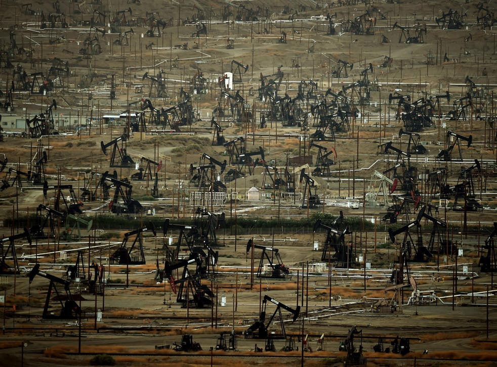Oil pumping jacks and drilling pads at the Kern River Oil Field where the principle operator is the Chevron Corporation in Bakersfield, California. The field is the third largest in California, fifth largest in the United States