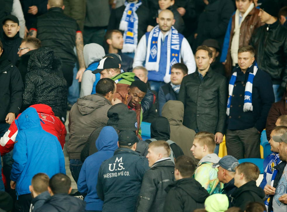Apparent Dynamo Kiev fans attack four black supporters during the match against Chelsea