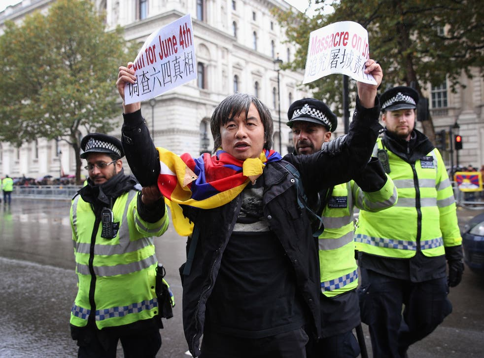 Shao Jiang protests outside Downing Street on Wednesday ahead of the arrival of Chinese President Xi Jinping