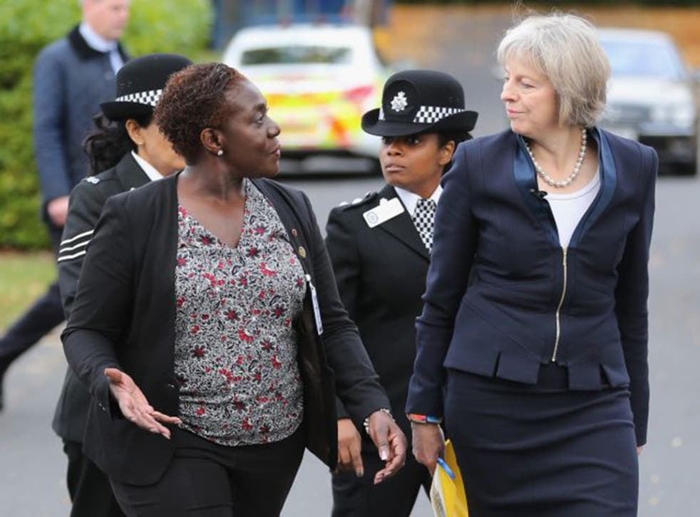 Home Secretary Theresa May, not always on the best of terms with the police, arrives at the National Black Police Association conference in Birmingham, escorted by NBPA chair Franstine Jones