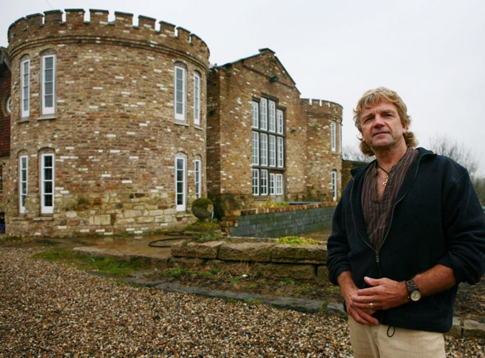 Robert Fidler outside the condemned home in Surrey that he built without planning permission