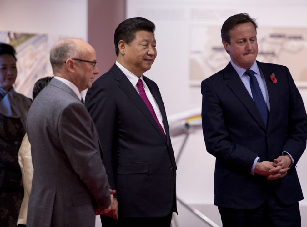 Xi Jinping and British Prime Minister David Cameron at Manchester Airport