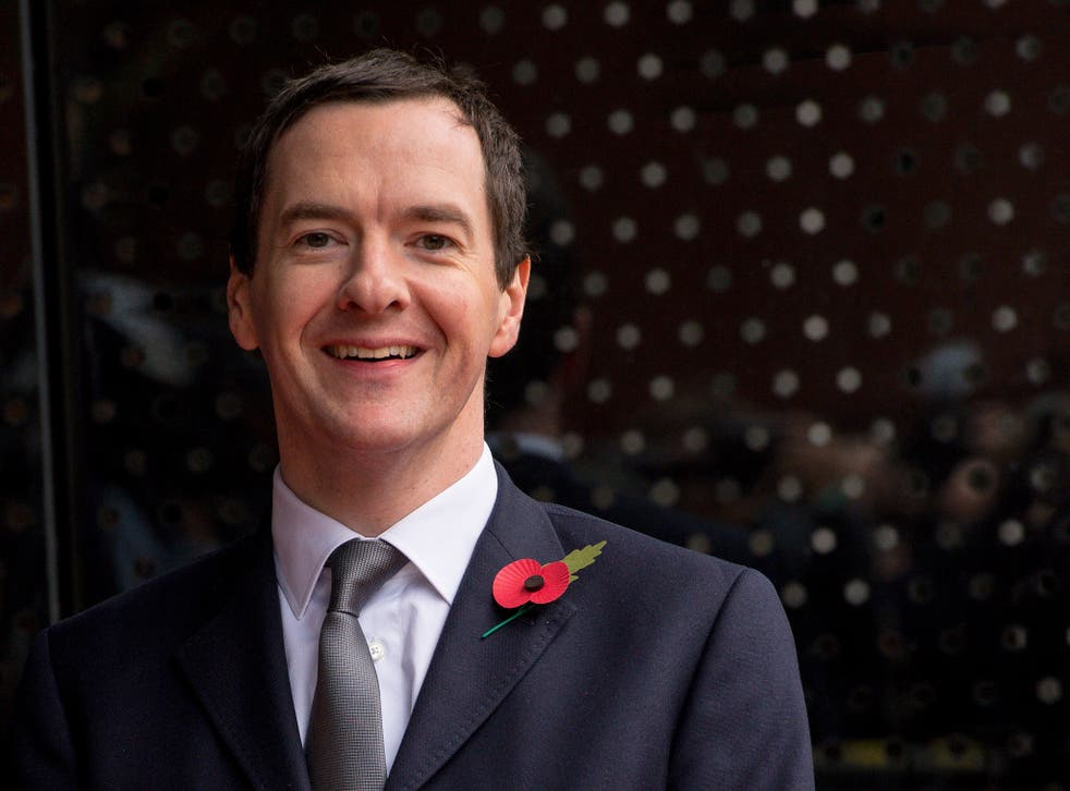 Britain's Chancellor of the Exchequer George Osborne waits for Chinese President Xi Jinping to arrive to tour the National Graphene Institute at Manchester University