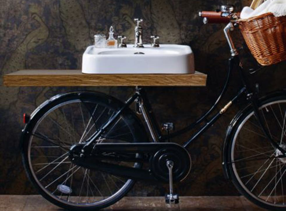 This made in England Pashley bicycle has a bathroom sink in the place of a saddle