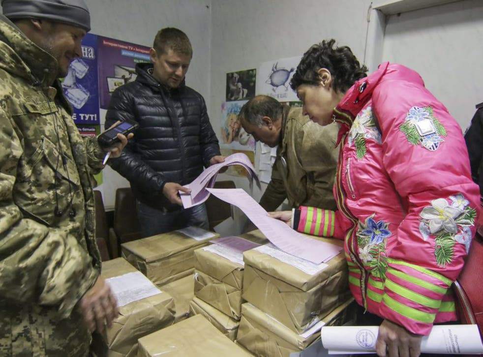 Mariupol activists check ballots at the plant owned by Rinat Akhmetov