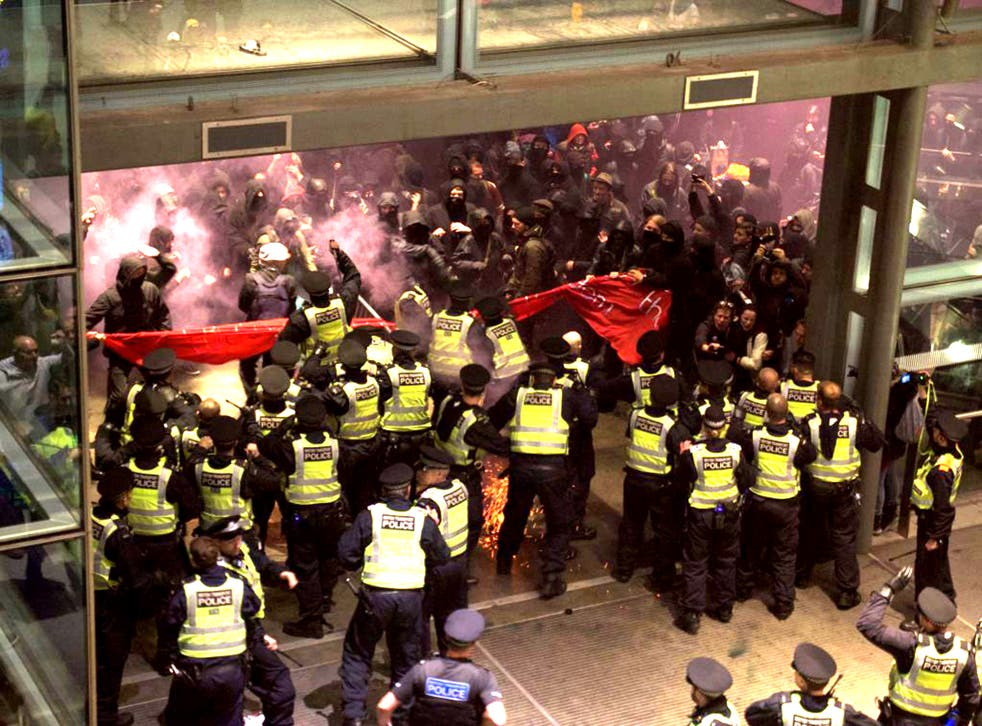 The demonstration began peacefully, but turned violent as protesters stormed police lines