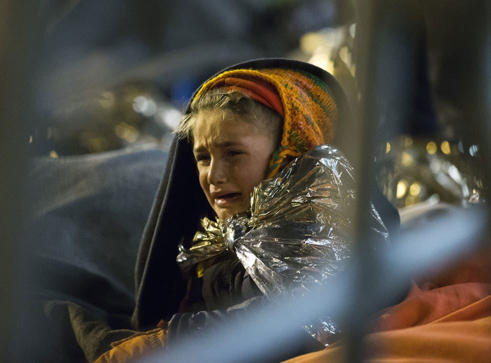 A refugee child cries at the camp at the Slovenian-Austrian border near Spielfeld, Austria, 24 October 2015