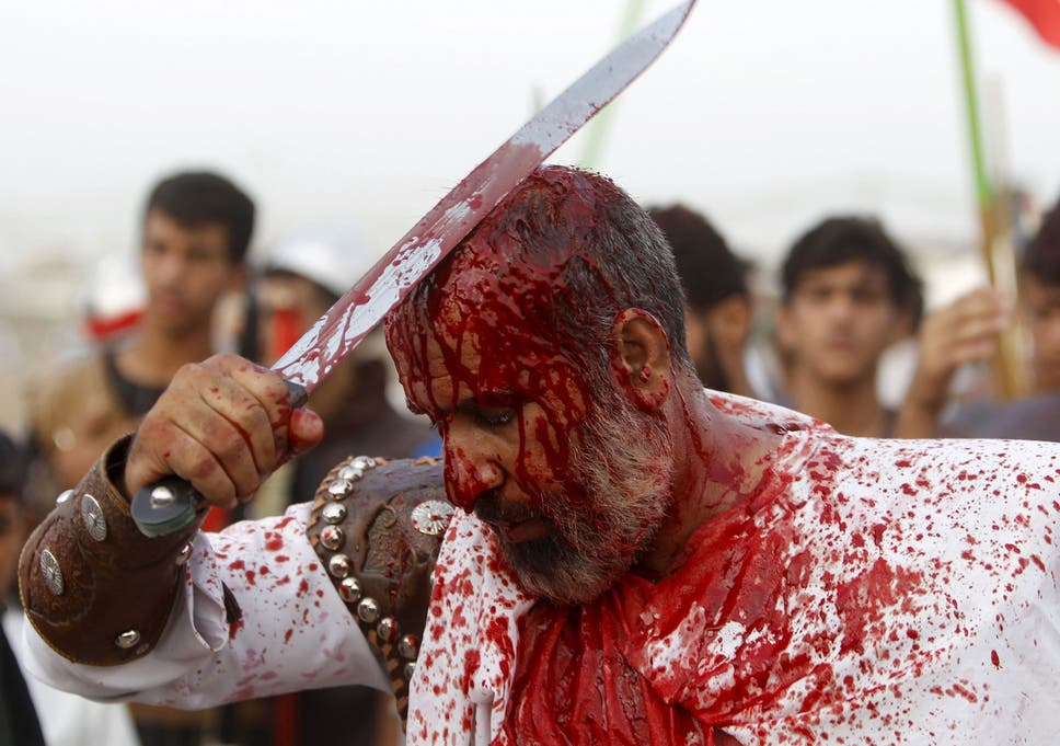 Shia Muslims slash and whip themselves to mourn the death of