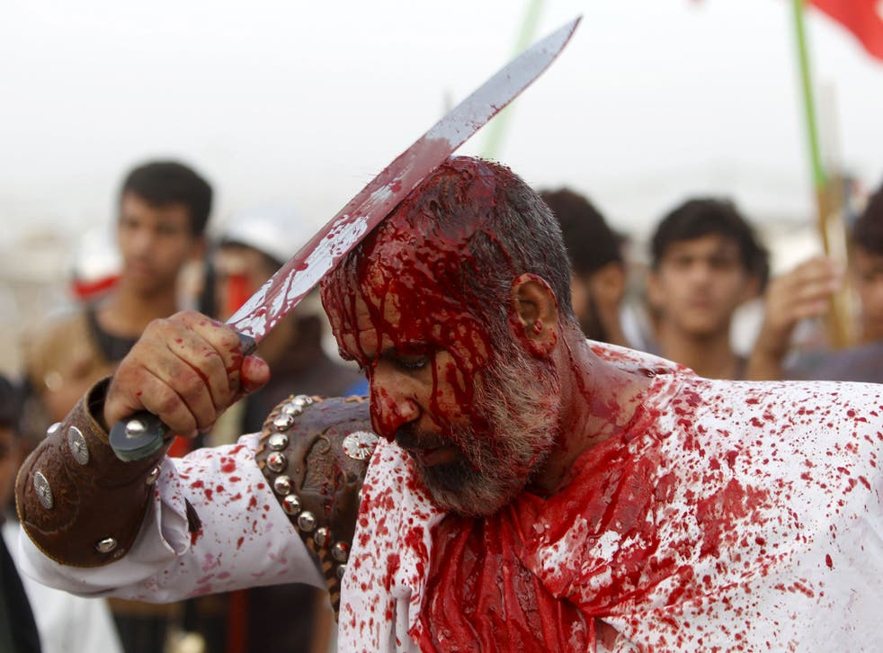 Iraq Shi'ite Muslim men bleed as they slice their foreheads with swords and beat themselves to commemorate Ashura in Sadr City, Baghdad.