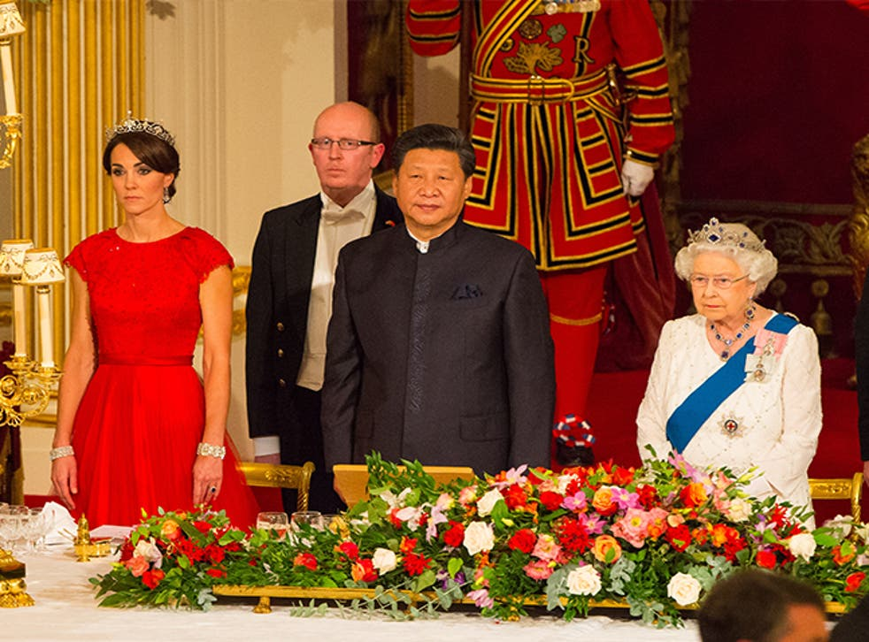 The Duchess of Cambridge, President of China Xi Jinping, and Britain's Queen Elizabeth II attend a state banquet at Buckingham Palace on October 20, 2015 in London