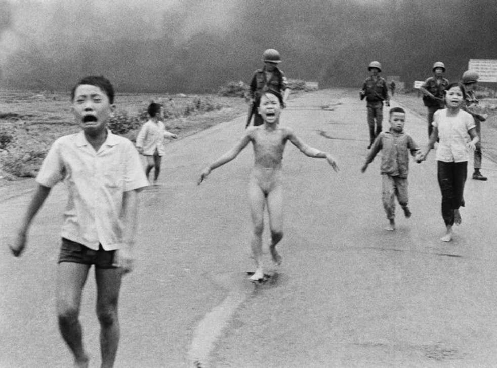 9-year-old Kim Phuc, center, runs with her brothers and cousins, followed by South Vietnamese forces