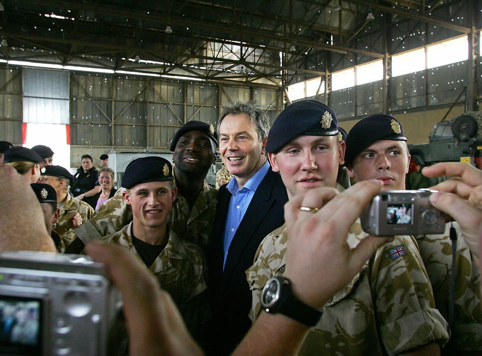 Tony Blair with British troops in Iraq in 2005. He implicitly denied on CNN he was a war criminal, saying he thought the impact of inaction in Syria was worse