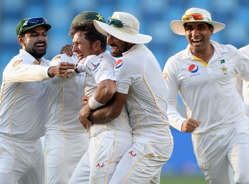 Yasir Shah celebrates the wicket of Adil Rashid to win the second Test for Pakistan