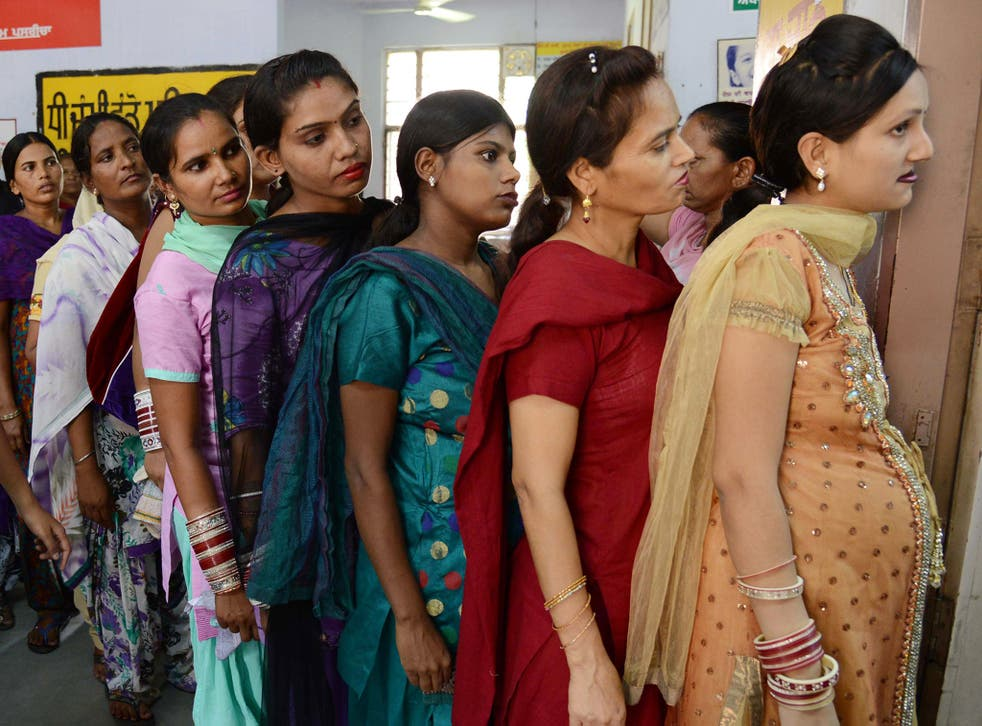 Pregnant Indian women wait for a check-up at a government hospital in Amritsar