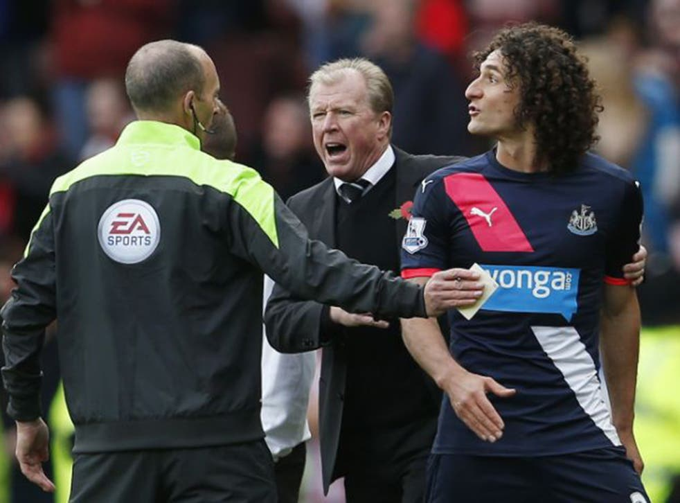 Newcastle captain Fabricio Coloccini  is shown the red card before half-time for barging Steven Fletcher