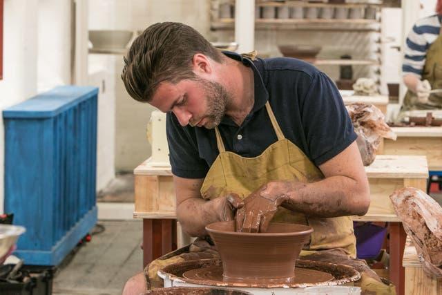 Bristol vet James hard at work on a pottery challenge